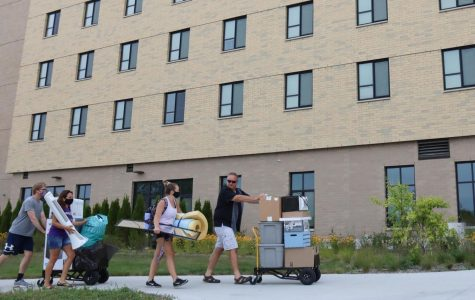 University of Wisconsin-Whitewater Sophomore Chloey Menarek (second from right) is assisted by family members while moving personal belongings into Ma'iingan Hall during Extended Drop Only Move-In on Aug. 22. Click through the slideshow for more move-in photos.