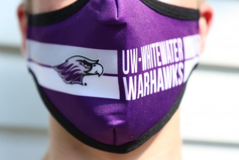 Photographer Dane Sheehan takes a self portrait wearing the new UW-Whitewater Warhawks mask.