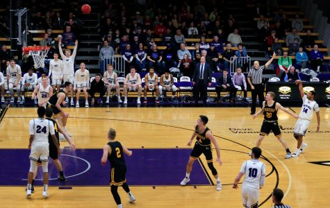 Senior guard Andre Brown (14) makes a three-point shot late in the second half to bring the Warhawks within one point of UW-Oshkosh in a WIAC conference game at the Williams Center on Wednesday, January 16, 2019.  The Warhawks could not overcome the No. 5 Titans but Brown in the first half became the 29th player in program history to reach 1,000 career points.
