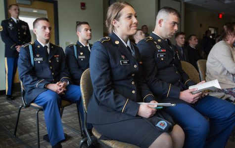 Cadets including UW-Whitewater junior Marli Kram, front, attend the commissioning ceremony for seniors Ethan Christensen and Adam Earle.  The Warhawk Company, Army Reserve Officers Training Corps at UW-Whitewater held its spring commissioning ceremony for two seniors prior to commencement on Saturday, May 13, 2017.  (UW-Whitewater photo/Craig Schreiner) DIGITAL MANIPULATION OF PHOTOGRAPHS OTHER THAN NORMAL MINIMAL CROPPING AND TONING IS PROHIBITED., CREDIT PHOTOS: UW-WHITEWATER PHOTO/CRAIG SCHREINER