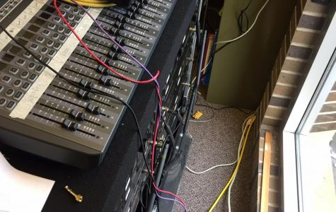 The UW-Whitewater's Vocal Jazz ensemble used this equipment for years, indoors. However, now the Choir uses the Mixers, wireless microphone receiver, and a FM transmitter for parking lot rehearsals. The FM transmitter is on the windowsill near the bottom.