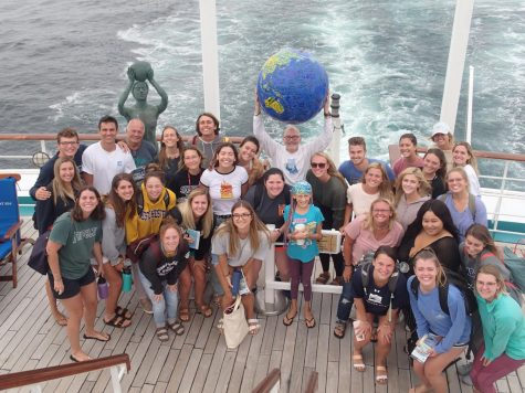 UW-W communication professor Susan Wildermuth snaps a group photo of her students and faculty members in the Semester at Sea program last spring.