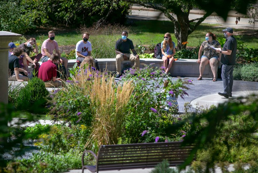 Matt Sintchak, professor of music, presides at an organizational meeting of music students who are members of the saxophone studio in the Campus Memory Garden, just outside Greenhill Center of the Arts. The garden was designed for small-group uses such as this. With plans for safe practices in place, in-person classes resumed on the UW-Whitewater campus on Wednesday, Sept. 2, 2020, the beginning of the fall semester. (UW-Whitewater photo/Craig Schreiner)