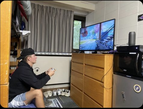 UW-WHITEWATER student plays competitive video games inside with his online friends