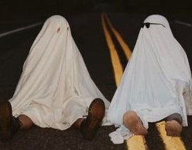 A photo taken by @maggiekraser from Tik Tok of her and her friend participating in the #GhostPhotoshoot trend.
