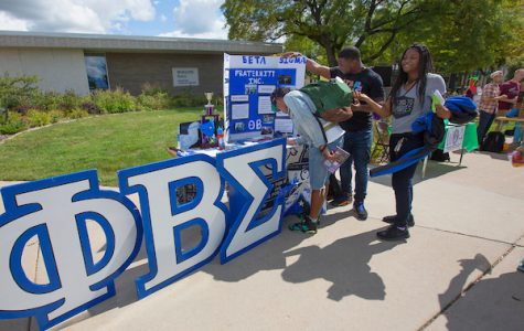 Giant letters can't be missed at the Phi Beta Sigma table.  Student organizations, clubs, fraternities and sororities showcase their activities at the annual Involvement Fair on the mall at UW-Whitewater on Wednesday, September 14, 2016.  (UW-Whitewater photo/Craig Schreiner) DIGITAL MANIPULATION OF PHOTOGRAPHS OTHER THAN NORMAL MINIMAL CROPPING AND TONING IS PROHIBITED., CREDIT PHOTOS: UW-WHITEWATER PHOTO/CRAIG SCHREINER