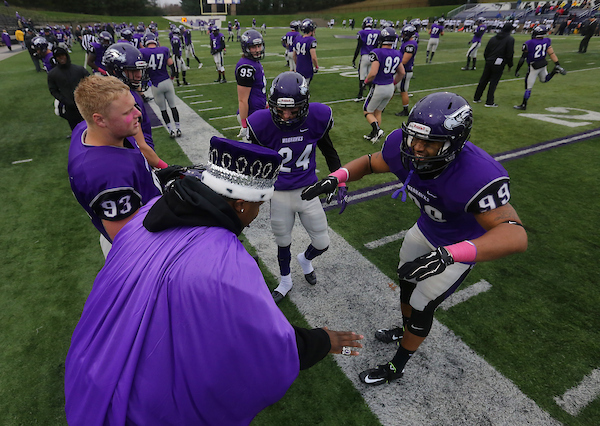 UW-Whitewater football players including Trevor Boyle (99), Brandon Tamsett (93) Jake Gierlak (24) celebrate a familiar presence, homecoming king Mykaell Bratchett, who started with the defense on the national championship team last year.UW-Whitewater celebrated its homecoming on Saturday, October 31, 2015 in Whitewater, Wis.  (UW-Whitewater Photo/Craig Schreiner) DIGITAL MANIPULATION OF PHOTOGRAPHS OTHER THAN NORMAL MINIMAL CROPPING AND TONING IS PROHIBITED., CREDIT PHOTOS: UW-WHITEWATER PHOTO/CRAIG SCHREINER