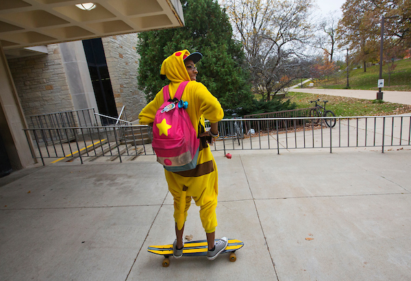 Dressed as the Pokemon character Pikachu, UW-Whitewater junior Jasmine Gilling sets out on her longboard from Anderson Library on October 31, 2017.  Jasmine said Halloween is the perfect day to enjoy her love of costumes. (UW-Whitewater photo/Craig Schreiner)  DIGITAL MANIPULATION OF PHOTOGRAPHS OTHER THAN NORMAL MINIMAL CROPPING AND TONING  IS PROHIBITED., CREDIT PHOTOS:  UW-WHITEWATER PHOTO/CRAIG SCHREINER