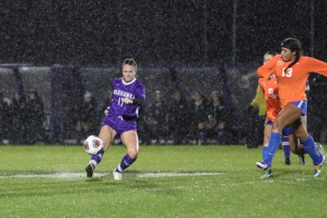 UW-Whitewater women's soccer senior defender Katy Kusswurm (17) kicks the ball in the rain, during a match against UW-Platteville in October 2019.