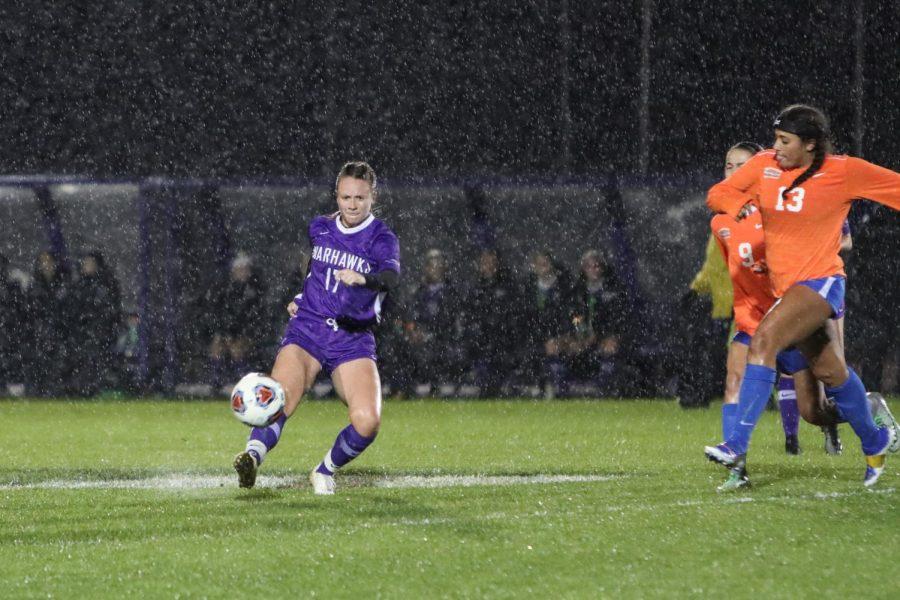 UW-Whitewater women's soccer senior defender Katy Kusswurm (17) kicks the ball in the rain, during a match against UW-Platteville in October 2019.