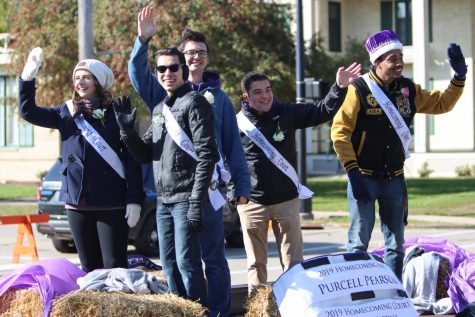 The 2019 Homecoming Court waves to the crowd from a float in the annual parade.