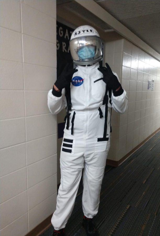 Astro the astronaut stops for a photo opp while leaping around campus.