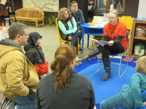 It was storytime, and Shannon Dozoryst read Louie's book out loud. When Dozoryst spoke, the community curiously listened, and were eager to learn. - photo courtesy of Young Auditorium