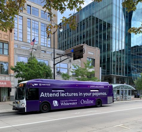A city bus makes a stop on the capitol square in Madison advertising online classes at UW-Whitewater.