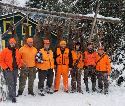 Jake Schumacher and his hunting party enjoy the rewards of a successful 2019 deer gun season hunt in Park Falls, Wisconsin.