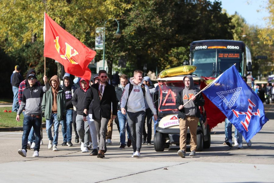 Delta+Chi+Fraternity+marches+in+the+UW-Whitewater+2019+Homecoming+Parade.+