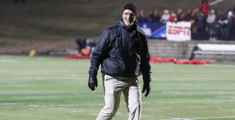 Head Coach of the UW-Whitewater football team Kevin Bullis walks off the field smiling, after the Warhawks defeated St. John's (MINN.) to advance to the 2019 Division III Football National Championship.
