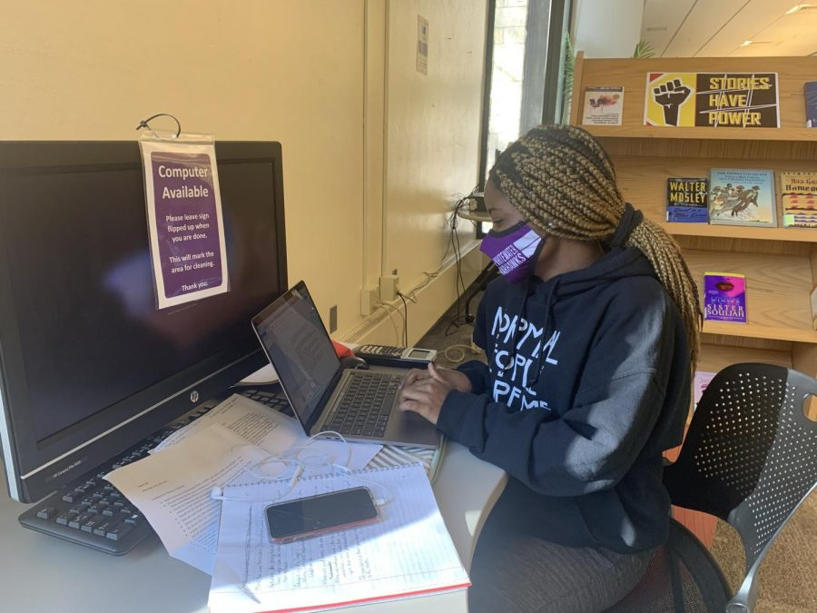 Freshman Biology Major Cleopatra Achemsa is utilizing the peaceful library space to write her upcoming English paper.