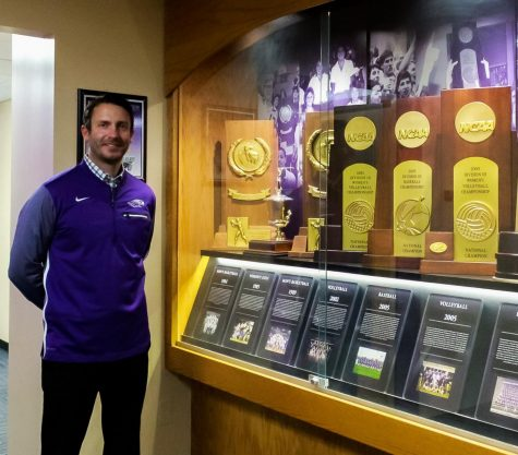 Standing next to the many women's championship trophies, Interim Director of Intercollegiate Athletics Ryan Callahan proudly celebrates 50 years of the Wisconsin Women's Intercollegiate Athletic Conference in the Williams Center Oct. 23.