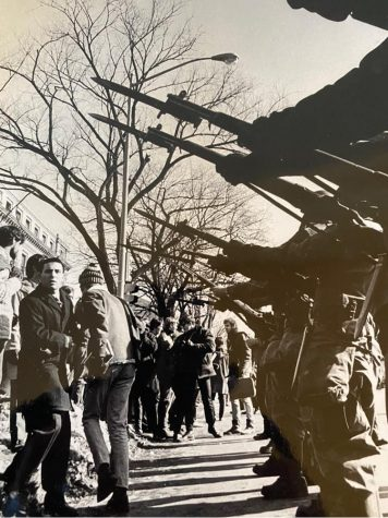 Sam Martino faces the bayonets of National Guard  soldiers during a protest on the University of Wisconsin-Madison campus in 1969.