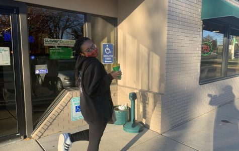 Freshman Julissa Donald is happy to receive her meal from the Whitewater Subway using the convenient mobile app.