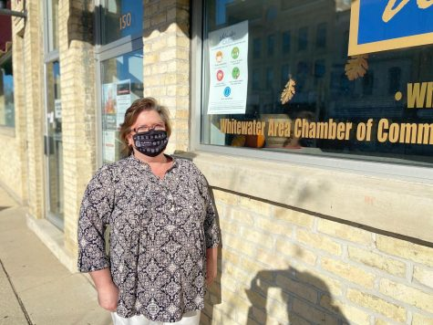 Executive Director of the Whitewater Area Chamber of Commerce and Tourism Council Kellie Carper stands outside the office on Main street Nov. 12 encouraging safe shopping this holiday season.