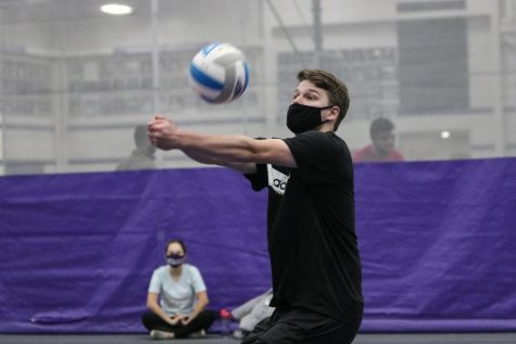 UW-Whitewater junior Eli Leising Bumps the ball during an intramural volleyball playoff match inside the Kachel Fieldhouse.