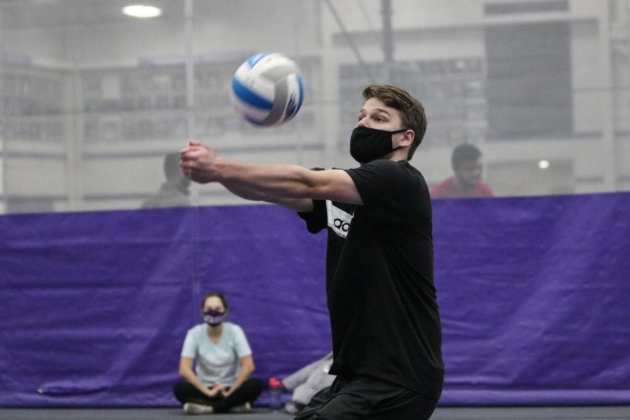 UW-Whitewater+junior+Eli+Leising+Bumps+the+ball+during+an+intramural+volleyball+playoff+match+inside+the+Kachel+Fieldhouse.