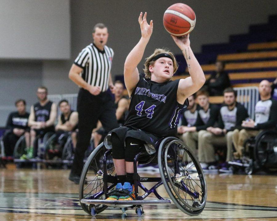 UW-Whitewater men's wheelchair basketball senior Jeromie Meyer #44 passes the ball during game against Illinois, in November 2019.