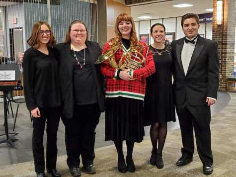 Left to the right, Kayla Okus, Clara McGowan, Miranda Johnson, Fai Haw and Kevin Zawila pose for a photo after the 2019 holiday gala.