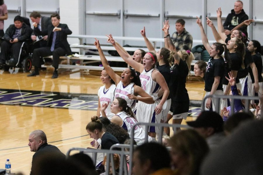 Members of the UW-Whitewater women's basketball team celebrate from the bench, during a game against UW-Oshkosh in Feb, 2020.