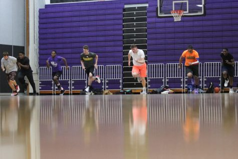 UW-Whitewater club basketball team members run across the Kachel Gymnasium floor during a team practice in November of 2019.