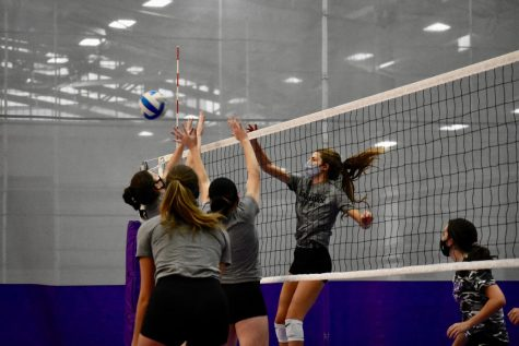 Outside Hitter on the UW-Whitewater women's volleyball team Chloe Buescher spikes the ball over the net during a practice inside the Kachel Fieldhouse.