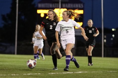 Member of the UW-Whitewater women's soccer team Anna Boyd #5 goes for the ball during a match against Ripon, at Fiskum Field in Sept, 2019.