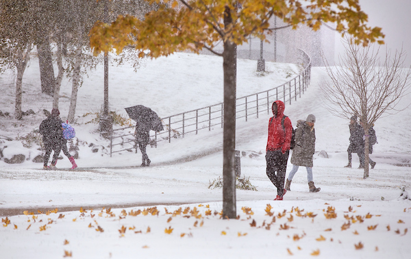 A combination of fall and winter beauty surrounds students as they walk to class on the UW-Whitewater campus. Snow and cold settle in at UW-Whitewater during a rare Halloween blizzard on Thursday, Oct. 31, 2019.   (UW-Whitewater photo/Craig Schreiner)