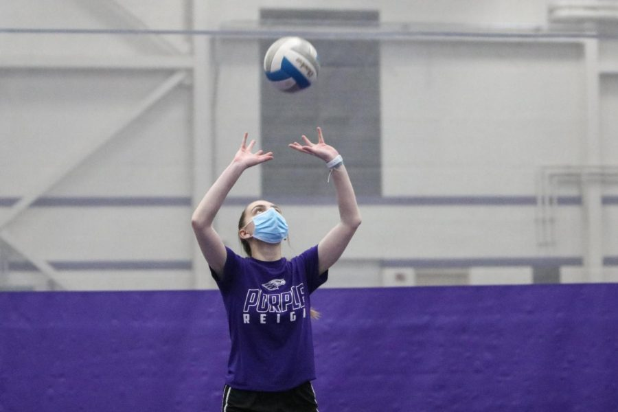 UW-Whitewater sophomore Mia Lubahn sets the ball during an intramural volleyball playoff match at the Kachel Fieldhouse in November 2020.