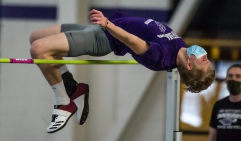 Quinn Halversen competes in the high jump during an intrasquad track & field meet inside the Kachel Fieldhouse on Saturday Jan. 23.