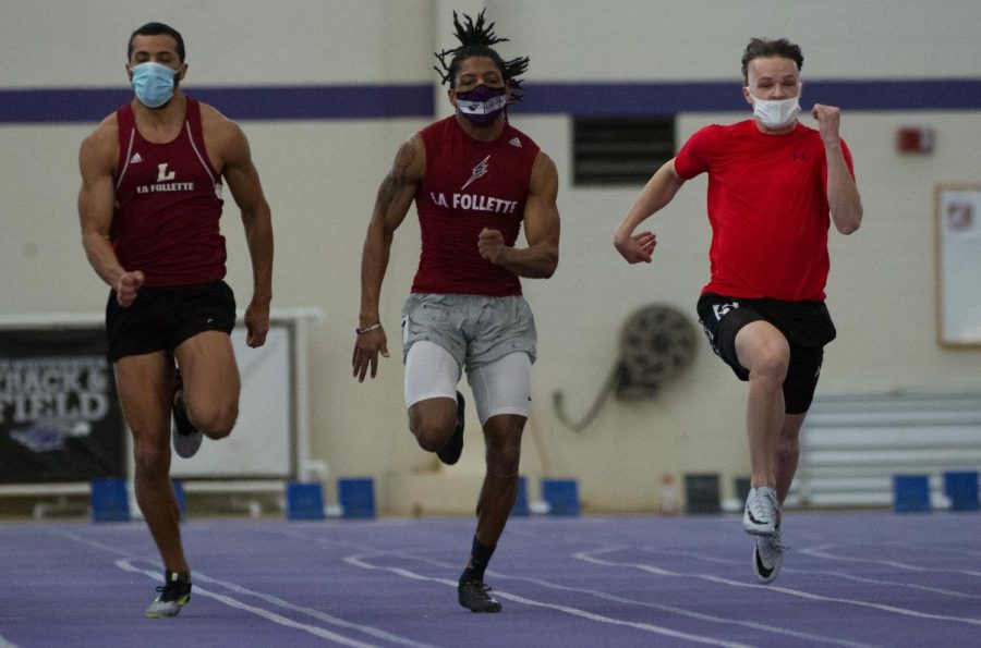 Oren Henderson-Zintz (left), Carl Wesley Jr. (center) and Nick Andersen sprint side-by-side while competing in an intrasquad track & field meet inside the Kachel Fieldhouse on Saturday Jan. 23.