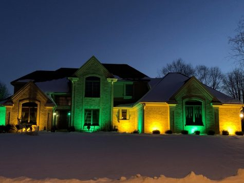 Joe and Janis Kluck show their Packer pride with green and gold lights shining at their Whitewater home on Mound View Place.