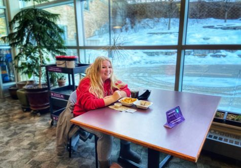 Alexus Hoelbl (pictured above)  enjoys her food while sitting socially distanced with her friends outside of Warhawk Alley located in the James R. Connor University Center on Friday, Jan 22.