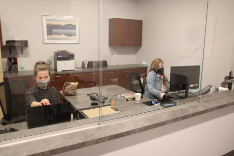 Client services Manager Danielle Sarver (left) and client services representative Penelope Kinsman sit at the front desk of the Pauquette Center for Psychological Services & Family Counseling in the UW-Whitewater Innovation Center.
