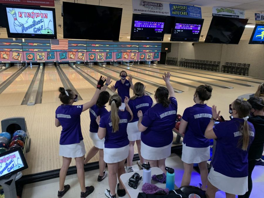 Senior Karlee Barton celebrates with her teammates, during day two of the Warhawk Classic tournament at Rock River Lanes in Fort Atkinson, Wisconsin Sunday, Jan. 31.