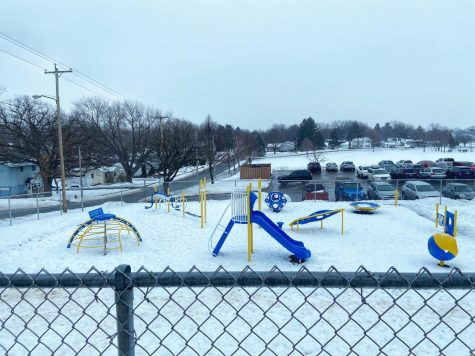 The empty snow covered playground sits beside Washington Elementary school in Whitewater, where students are scheduled to resume in-person attendance on Monday Jan. 18.