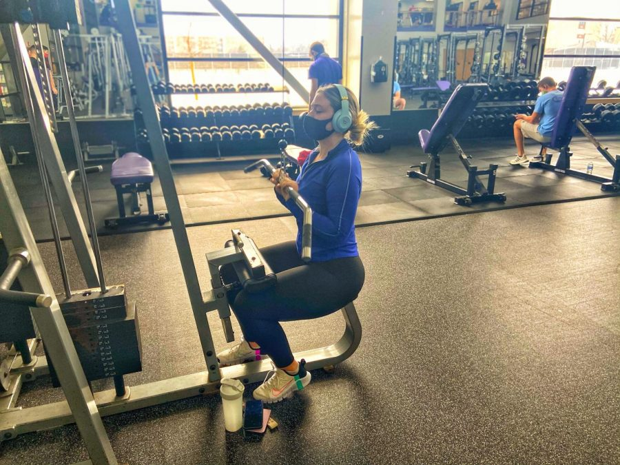 Caroline Casey works out inside the Williams Center weight room.