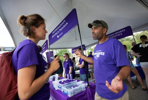 Associate professor of physics Jalal Nawash gives information to exchange student Lisa Wetzlmair of the Netherlands at the Undergraduate Research table. Games, prizes, information, music, dancing and fun are rolled into one event for new students at Hawk Fest on the UW-Whitewater campus on Monday, Sept. 2, 2019, on the day before fall classes begin. (UW-Whitewater photo/Craig Schreiner)