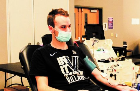 Student Preston Pagel donates blood at the Community Engagement Center Feb. 10.