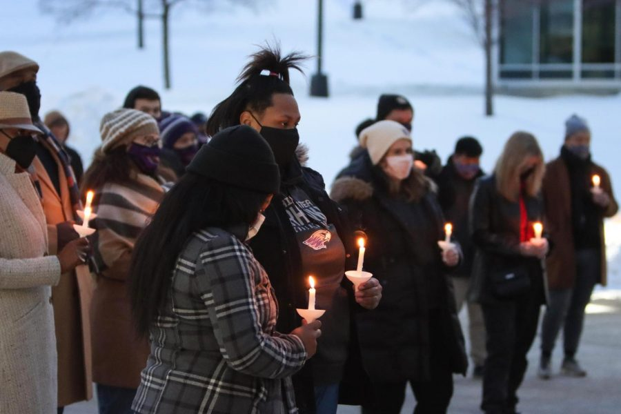 The UW-Whitewater community held a candlelight vigil Feb. 17 for alum Purcell Pearson who was fatally shot in downtown Milwaukee.