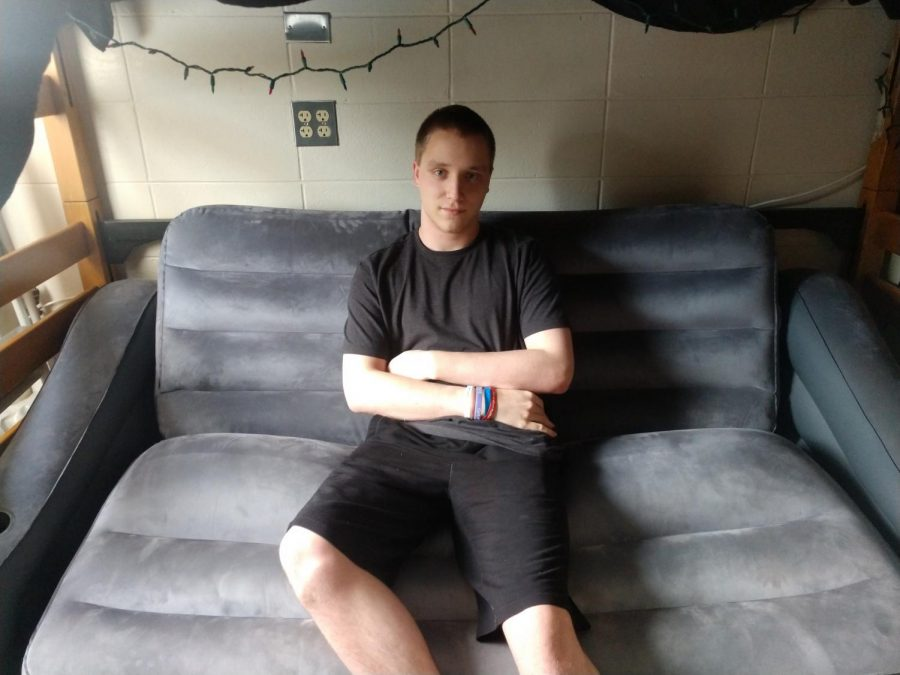 Information Technology major Tyler LoPiore sits on a classy inflatable futon in his Knilans Hall dorm room. Can futons seriously be any more amazing?