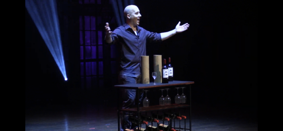 Magician Bill Blagg performs a trick where he multiples wine bottles Feb. 20 in the Young Auditorium.