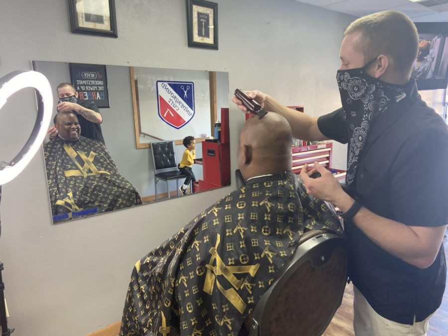 Underground Cutz barber Levi Schmitz give UW-Whitewater Chancellor Dwight Watson a haircut Saturday Feb. 20.